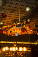 Luxurious stunning beautiful New Year's vintage festive ceiling decorated with a variety of balls and garlands. Christmas decoration. Magical atmosphere. Close-up
