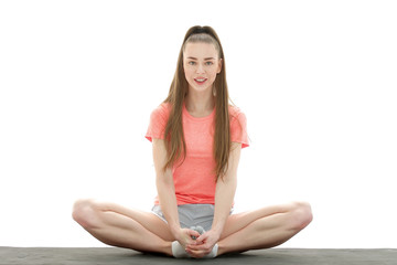 ractice of yoga. modern woman in sports clothing training yoga position