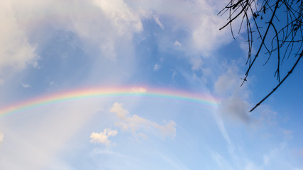 Beautiful Classic Rainbow Across In The Blue Sky After The Rain, Rainbow Is A Natural Phenomenon That Occurs After Rain.