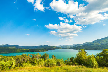 Scenic view on the Butoniga reservoir lake on a summer sunny day Wall mural