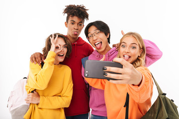Group of cheerful teenagers isolated