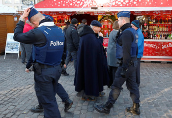 Belgian police officers patrol the area of Christmas market in central Brussels