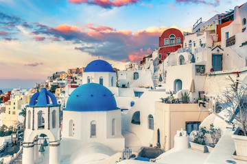 Fototapete - Beautiful view of Oia, Santorini island in Greece, at sunrise with dramatic sky.