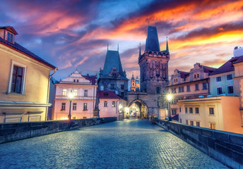 Charles bridge in Prague, Czech republic, at sunset. Scenic travel background.