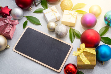 Empty blackboard with christmas decorations ball and gift boxs. Background, backdrop, wallpaper.