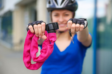 Girl with bicycle  lock. Bicycle U- lock