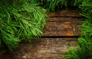 Vintage  Christmas holiday wooden planks rural background. Beautiful Empty Christmas Backdrop.  New Year Background.  Xmas background with pine branches