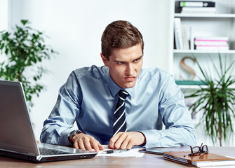 Angered worker with unhappy of facial expression. Photo of young man working in the office. Business concept