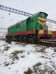 Industrial landscape. Railway and shunting diesel locomotive. Winter season.