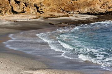 Waves Crashing on Rocks on the Beach