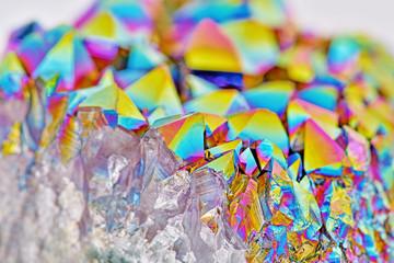 Amazing colorful flashing Amethyst Quartz Rainbow Titanium Aura Crystal cluster closeup with shallow depth of field. Macro of beautiful rare sparkly rainbow mineral stone