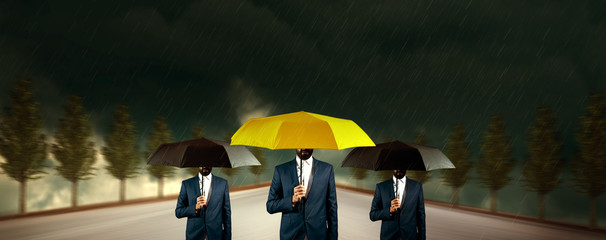 hands black and yellow umbrella