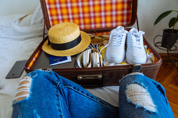 suitcase with clothes ready for trip. travel concept. copy space