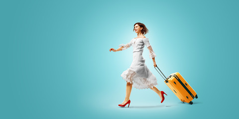Fototapeta young beautiful woman arrived on vacation. She is Traveling very happy wallking with suitcase. color gradient background obraz