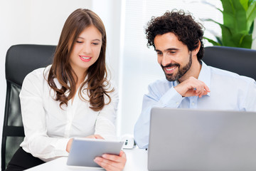 Business partners using a digital tablet