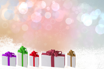Christmas decoration background. A row or group  of colorful christmas gift boxes with snow on a beautiful pink bokeh background. Space for your design.