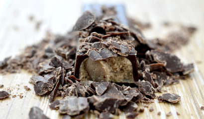 chocolate crumbs on wood background,.shallow dof