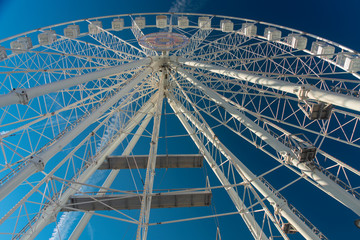 View looking up at a ferris wheel from below