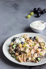 Tuna, green and black grapes salad with natural yogurt dressing. Healthy or food. Light breakfast, lunch or dinner.