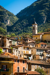 Hillside village with church in the southern Alps, Provence, France, warm colours
