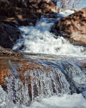 Gentle water fall at a state park in Alabama with a bokeh background.