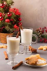 Christmas eggnog in glass mug and cinnamon.