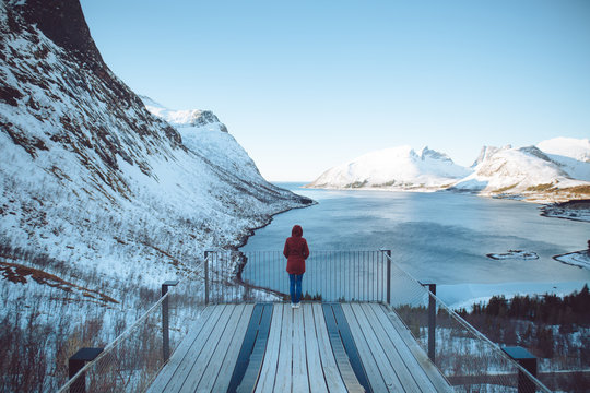 Person looking at snow covered mountains and river