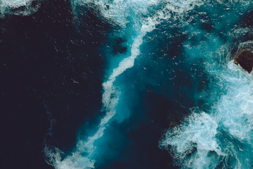 Aerial view of waves and splash in the water