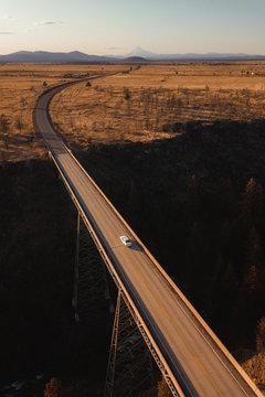 A car driving on a bridge