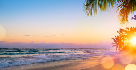 Foto auf Leinwand Karibik Art Beautiful sunrise over the tropical beach
