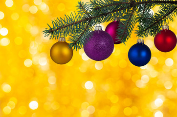 Colorful Christmas balls on Christmas tree with Golden background