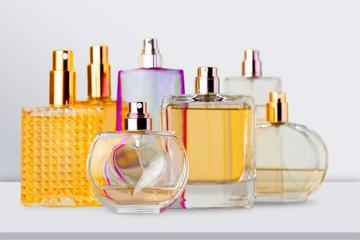 Aromatic Perfume bottles on white wooden desk at wooden