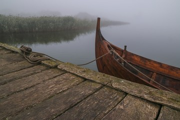 Papiers peints Pont viking ship at a wooden pier with fog in Hedeby
