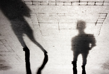 Blurry shadow silhouettes of two people