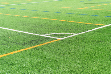 Soccer field with a new artificial turf field, white corner marking. Close up. Soccer background. Copy space