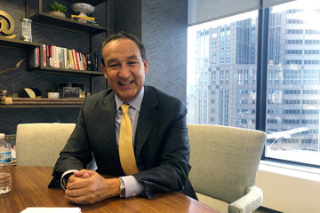 United Airlines Chief Executive Officer Oscar Munoz poses for pictures in his office at the company's headquarters in Chicago