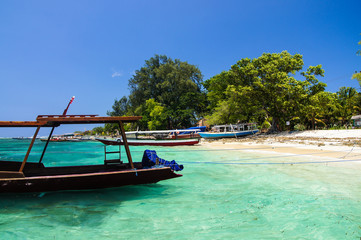 Sandy beach with azure water and boat Parking on the tropical island of Gili Air