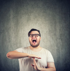 Screaming man in stress asking for time out