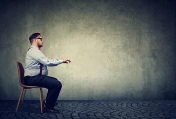 Man sitting at imaginary table