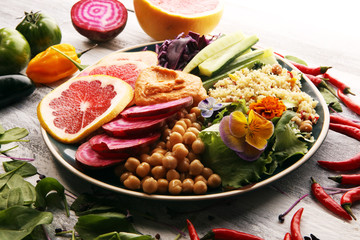 Bowl of Buddha, The concept of a healthy diet: chickpeas, salad, beetroot, pumpkin, cucumber, grapefruit, cabbage and tabouleh. Balanced food.