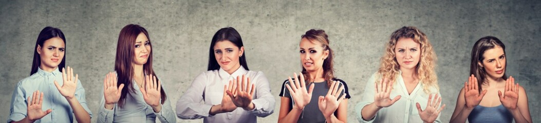 Group of multicultural upset women gesturing stop to abuse domestic violence
