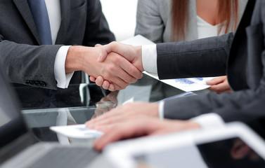 handshake partners at the Desk