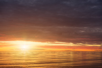 Red Sunset Over the Sea, Rich In Dark Clouds, Rays Of Light. Morning Glory In Heaven