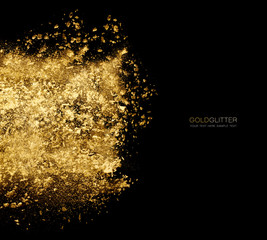 Golden glitter powder scattered in black . Gold dust explosion