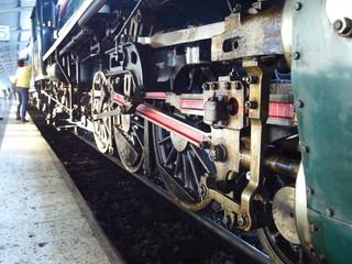 Bangkok,Thailand-December 5, 2013: Driving wheels of a steam locomotive train at Hua Lamphong station in Bangkok