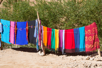Africa, North Africa, Morocco, Souss-Massa-Drâa, Todra Gorge, cloth hanging on line, used for creating colorful head scarves, Moroccan shesh (Touareg turbans).