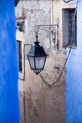 """Morocco, Chefchaouen, """"The Blue City"""" or """"blue Medina"""", a street lantern graces the blue painted medina walls."""