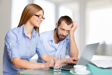 Portrait of cheerful Couple on the couch using laptop