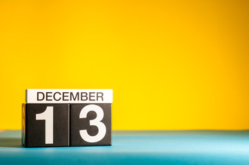 December 13th. Image 13 day of december month, calendar on yellow background with empty space for text