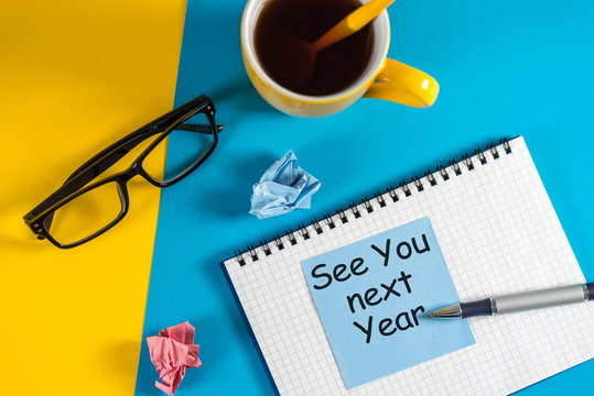 See you next year written on a message at the workplace